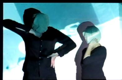 garlando's 'leftrightcenter' with jeff fouch and eve hermann, still from video by coco loupe